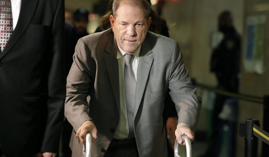 FILE - In this Jan. 7, 2020, file photo, Harvey Weinstein arrives at court for the start of jury selection in his sexual assault trial in New York. The convicted former movie producer is expected to appear briefly via video from a New York prison Friday, Dec. 11, 2020, as part of legal efforts to send him to California to face sexual assault charges. (AP Photo/Seth Wenig, File)