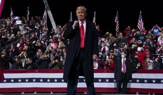 President Donald Trump walks off stage after a campaign rally for Senate Republican candidates, Sen. Kelly Loeffler, R-Ga., and Sen. David Perdue, R-Ga.,at Valdosta Regional Airport, Saturday, Dec. 5, 2020, in Valdosta, Ga. (AP Photo/Evan Vucci)