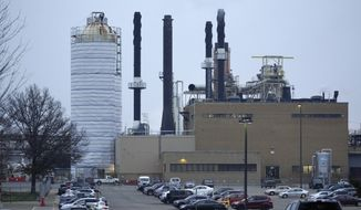 The Pfizer Global Supply Kalamazoo manufacturing plant is shown in Portage, Mich., Friday, Dec. 11, 2020. Pfizer's COVID-19 vaccine won an endorsement Thursday, Dec. 10, from a Food and Drug Administration panel of outside advisers, and agency signoff is the next step needed to get the shots to the public. (AP Photo/Paul Sancya)