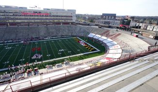 Empty stands are visible during the second half of an NCAA college football game between Maryland and Rutgers, Saturday, Dec. 12, 2020, in College Park, Md. Rutgers won 27-24 in overtime. (AP Photo/Julio Cortez)  **FILE**