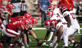 The Maryland offense, left, lines up agains the Rutgers defense during the first half of an NCAA college football game, Saturday, Dec. 12, 2020, in College Park, Md. (AP Photo/Julio Cortez)