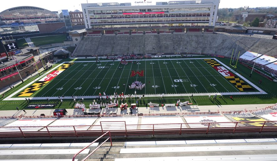 Empty stands are visible during the second half of an NCAA college football game between Maryland and Rutgers, Saturday, Dec. 12, 2020, in College Park, Md. Rutgers won 27-24 in overtime. (AP Photo/Julio Cortez)
