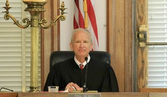 FILE - In this May 15, 2019, file photo, Senior Associate Justice Paul Newby presides at a special session of the Supreme Court of North Carolina at New Bern City Hall in New Bern, N.C. Republican Paul Newby's narrow lead over Democratic incumbent Cheri Beasley changed little overall as a statewide machine recount of North Carolina's very close race for Supreme Court chief justice was finally completed, late Wednesday, Dec. 2, 2020. (Gray Whitley/Sun Journal via AP, File)