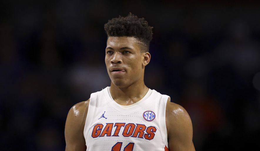 In this Nov. 29, 2019, file photo, Florida forward Keyontae Johnson (11) looks on during during the first half of an NCAA college basketball game against Marshall in Gainesville, Fla.  Johnson, the Southeastern Conference's preseason player of the year, collapsed coming out of a timeout against rival Florida State and needed emergency medical attention Saturday, Dec. 1`2, 2020. He was taken off the floor on a stretcher and rushed to Tallahassee Memorial for evaluation. The Gators had no immediate update on his condition. (AP Photo/Matt Stamey, File) **FILE**