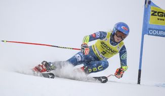 United States' Mikaela Shiffrin speeds down the course during an alpine ski, women's World Cup giant slalom in Courchevel, France, Saturday, Dec. 12, 2020. (AP Photo/Marco Trovati)