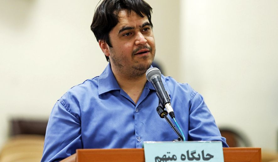 File - In this June 2, 2020 file photo, journalist Ruhollah Zam speaks during his trial at the Revolutionary Court, in Tehran, Iran. Iran. Tranian state television and the state-run IRNA news agency say Ruhollah Zam was hanged early Saturday, Dec. 11, 2020, just months after he returned to Tehran under mysterious circumstances. (Ali Shirband/Mizan News Agency via AP, File)