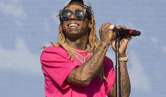 FILE - In this Saturday, June 16, 2018 file photo, Lil Wayne performs on Day 3 of the 2018 Firefly Music Festival at The Woodlands in Dover, Del. Rapper Lil Wayne has pleaded guilty, Friday, Dec. 11, 2020 to a federal charge that he possessed a weapon despite being a convicted felon following a 2019 search of a private plane in the Miami area. (Photo by Owen Sweeney/Invision/AP, File)