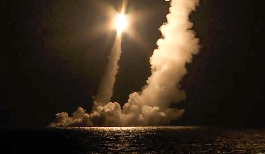 In this photo taken from video distributed by Russian Defense Ministry Press Service, Intercontinental ballistic missiles are launched by the Vladimir Monomakh nuclear submarine of the Russian navy from the Sera of Okhotsk, Russia, Saturday, Dec. 12, 2020. The submarine successfully test-fired four intercontinental ballistic missiles in a show of readiness of the nation's nuclear deterrent. (Russian Defense Ministry Press Service via AP) ** FILE **