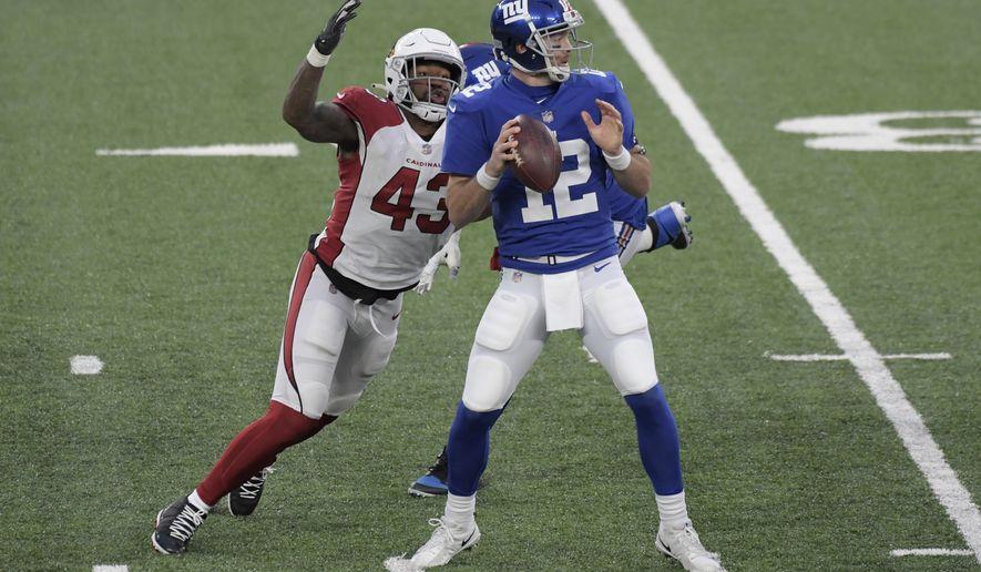 Arizona Cardinals' Haason Reddick, left, pressures New York Giants quarterback Colt McCoy during the second half of an NFL football game, Sunday, Dec. 13, 2020, in East Rutherford, N.J. (AP Photo/Bill Kostroun)