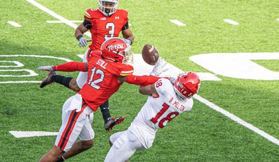 Tarheeb Still (12) breaks up a pass in Maryland's loss to Rutgers at Maryland Stadium on Saturday. (Abdullah Konte, All Pro Reels Photography)