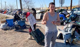 Jacob Garcia-Rader, resident of a tent city encampment on 33rd Street speaks Tuesday, Dec. 1, 2020, in Ogden, Utah. (Tim Vandenack/Standard-Examiner via AP)