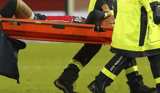 PSG's Neymar is carried off the field on a stretcher after getting injured during the League One soccer match between Paris Saint Germain and Lyon, at the Parc des Princes stadium in Paris, France, Sunday, Dec. 13, 2020. (AP Photo/Thibault Camus)