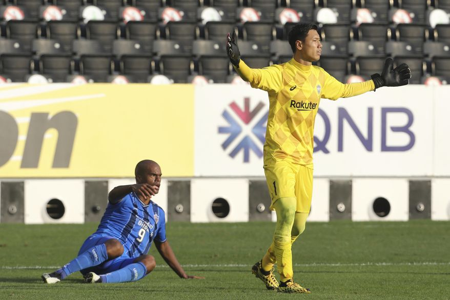 Ulsan Hyundai's Júnior Negrão, left, reacts as he claims a penalty after a challenge during the Champions League semifinal soccer match between Vissel Kobe and Ulsan Hyundai FC at Jassim Bin Hamad Stadium in Doha, Qatar, Sunday, Dec. 13, 2020. (AP Photo/Hussein Sayed)