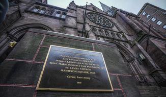 A plaque sits at the steps of St. James Episcopal Church, Friday Dec. 4, 2020, in New York's Upper East Side neighborhood, acknowledging the church's wealth created with slave labor. (AP Photo/Bebeto Matthews)