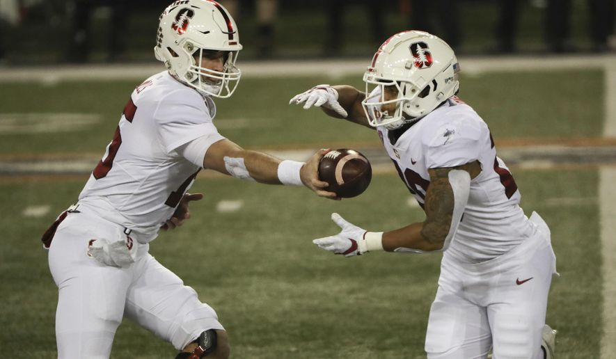 Stanford quarterback Davis Mills (15) hands off to running back Austin Jones (20) during the first half of the team's NCAA college football game against Oregon State in Corvallis, Ore., Saturday, Dec. 12, 2020. (AP Photo/Amanda Loman)