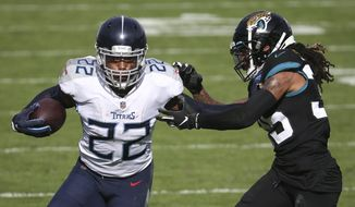 Tennessee Titans running back Derrick Henry (22) gains yardage as he tries to get around Jacksonville Jaguars cornerback Sidney Jones during the first half of an NFL football game, Sunday, Dec. 13, 2020, in Jacksonville, Fla. (AP Photo/Stephen B. Morton)