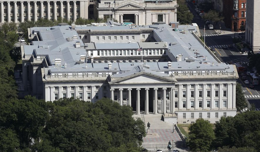 The U.S. Treasury Department building viewed from the Washington Monument, Wednesday, Sept. 18, 2019, in Washington. Hackers got into computers at the U.S. Treasury Department and possibly other federal agencies, touching off a government response involving the National Security Council. Security Council spokesperson John Ullyot said Sunday, Dec. 13, 2020, that the government is aware of reports about the hacks. (AP Photo/Patrick Semansky, File)