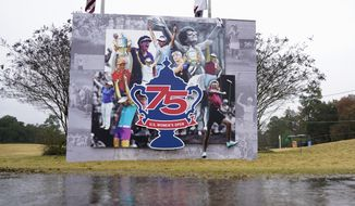 Rain falls during a weather delay in the final round of the U.S. Women's Open golf tournament, Sunday, Dec. 13, 2020, in Houston. (AP Photo/David J. Phillip)