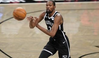 Brooklyn Nets forward Kevin Durant (7) passes during the first half of a preseason NBA basketball game against the Washington Wizards, Sunday, Dec. 13, 2020, in New York. (AP Photo/Kathy Willens)