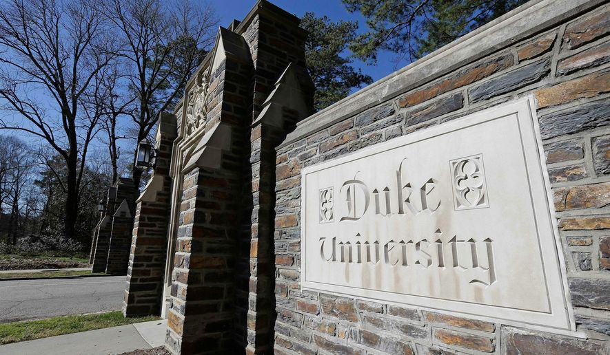 Duke University, which held in-person classes this semester, tested 6,000-plus undergraduates twice weekly for COVID-19 and reported a positivity rate well below 1%. (ASSOCIATED PRESS PHOTOGRAPHS)