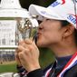"""A Lim Kim became the seventh player to rally from five shots behind in the final round to win the U.S. Women's Open on Monday. """"Still can't really soak in that I'm the champion,"""" she said of her Open debut. (ASSOCIATED PRESS)"""