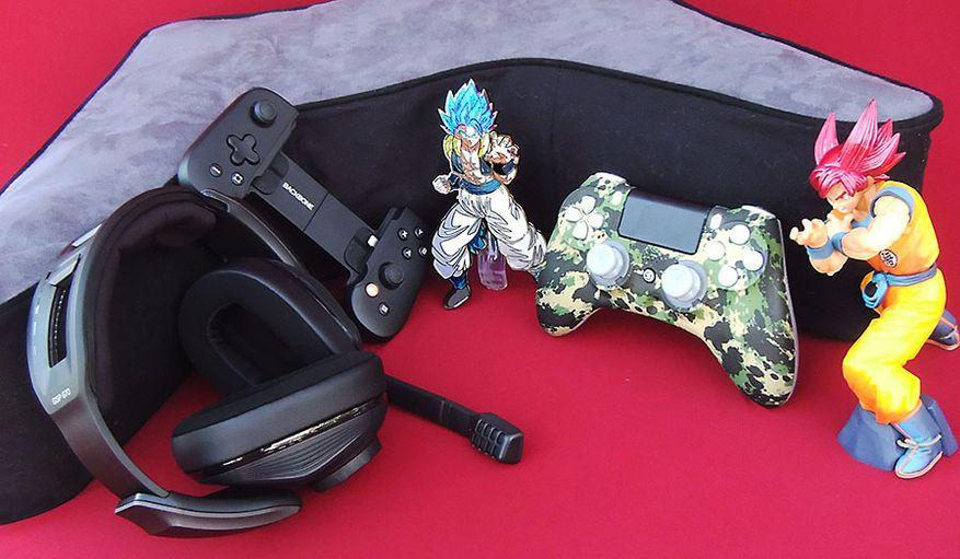 Gaming gift picks include EPOS/Sennheiser's GSP 670 wireless headset, Backbone's Backbone One, FIGPins' Gogeta, Scuf Gaming's Impact PS4 controller and Exo Scuf and Banpresto's Super Saiyan God Goku. (Photograph by Joseph Szadkowski / The Washington Times)