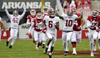 Alabama punt returner DeVonta Smith (6) returns a punt for a touchdown against Arkansas during the first half of an NCAA college football game Saturday, Dec. 12, 2020, in Fayetteville, Ark. (AP Photo/Michael Woods) **FILE**