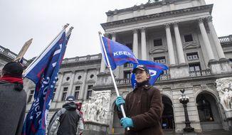 Supporters of President Donald Trump protest outside the Capitol Complex in Harrisburg, Pa., as the electoral college convenes, Monday, Dec. 14, 2020. (Jose Moreno/The Philadelphia Inquirer via AP)