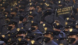 Army cadets cheer against Navy during the second half of an NCAA college football game Saturday, Dec. 12, 2020, in West Point, N.Y. It was the 121st playing of the Army-Navy game played in Michie Stadium at the United States Military Academy. Army defeated Navy 15-0. (AP Photo/Adam Hunger)