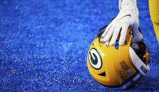 Green Bay Packers cornerback Kevin King (20) rests his hand on his helmet as he takes a knee against the Detroit Lions during an NFL football game, Sunday, Dec. 13, 2020, in Detroit. (AP Photo/Rick Osentoski)