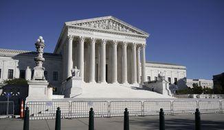 In this Nov. 4, 2020, photo, The Supreme Court in Washington is shown here. (AP Photo/J. Scott Applewhite) **FILE**