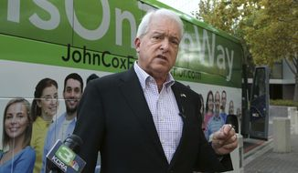 FILE - In this Nov. 1, 2018, file photo, Republican gubernatorial candidate John Cox talks to reporters before beginning a statewide bus tour in Sacramento, Calif. California Gov. Gavin Newsom is facing a possible recall election as the nation's most populous state struggles to emerge from the coronavirus crisis. Newsom's challenging year has already encouraged Republicans who have signaled they are likely candidates, including former San Diego Mayor Kevin Faulconer and Newsom's 2018 rival, businessman Cox. (AP Photo/Rich Pedroncelli, File)
