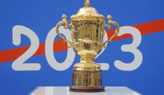 FILE - In this Sept. 8, 2020 file photo, the Webb Ellis Cup is displayed during a presentation in Paris. The 2023 Rugby World Cup will take place in France from sept.8 2023 to oct. 21 2023. (AP Photo/Michel Euler, File)