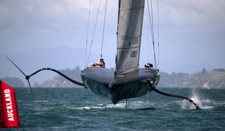 American Magic, the U.S. entry for the America's Cup yachting regatta practices on the harbor in Auckland, New Zealand, on Monday, Dec. 14, 2020. American Magic is one of three challengers from the United States, Italy and Britain which will emerge to race defender Team New Zealand for the America's Cup in the 36th regatta in March. (Dean Purcell/New Zealand Herald via AP)