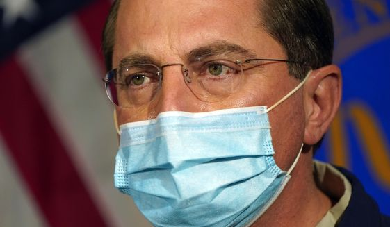 Then-Health and Human Services Secretary Alex Azar speaks at George Washington University Hospital, Monday, Dec. 14, 2020, in Washington, before watching COVID-19 vaccines being administered to hospital workers. (AP Photo/Jacquelyn Martin, Pool) ** FILE **