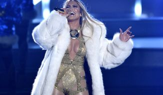 """FILE - Video Vanguard award recipient Jennifer Lopez performs at the MTV Video Music Awards in New York on Aug. 20, 2018.  Lopez will help bring in the New Year with a headlining performance in New York's Time Square for """"Dick Clark's New Year's Rockin' Eve with Ryan Seacrest 2021."""" ABC and dick clark productions announced Tuesday that the pop star will perform live before the icon ball drop on Dec. 31. Because of the coronavirus pandemic, the event will be closed to the public. (Photo by Chris Pizzello/Invision/AP, File)"""