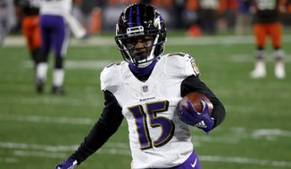 Baltimore Ravens wide receiver Marquise Brown (15) runs with the ball during an NFL football game against the Cleveland Browns, Monday, Dec. 14, 2020, in Cleveland. (AP Photo/Kirk Irwin)  **FiLE**