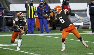 Cleveland Browns quarterback Baker Mayfield (6) attempts to deflect the ball back to wide receiver Jarvis Landry (80) in an attempt to keep the last play of the game alive during an NFL football game against the Baltimore Ravens, Monday, Dec. 14, 2020, in Cleveland. (AP Photo/Kirk Irwin)