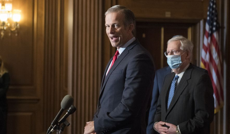 Senate Majority Leader Mitch McConnell of Ky., listens as John Thune, R-S.D., speaks during a news conference with other Senate Republicans on Capitol Hill in Washington, Tuesday, Dec. 15, 2020. (Rod Lamkey/Pool via AP)  **FILE**