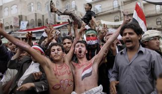 FILE - In this March 26, 2011 file photo, anti-government protestors react during a demonstration demanding the resignation of Yemeni President Ali Abdullah Saleh, in Sanaa, Yemen. Ten years ago, an uprising in Tunisia opened the way for a wave of popular revolts against authoritarian rulers across the Middle East known as the Arab Spring. For a brief window as leaders fell, it seemed the move toward greater democracy was irreversible. Instead, the region saw its most destructive decade of the modern era. Syria, Yemen, Libya and Iraq have been torn apart by wars, displacement and humanitarian crisis. (AP Photo/Muhammed Muheisen, File)