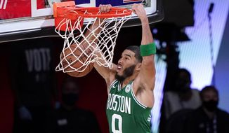 FILE - Boston Celtics' Jayson Tatum (0) dunks the ball during the first half of an NBA conference final playoff basketball game against the Miami Heat, in Lake Buena Vista, Fla., in this on Saturday, Sept. 19, 2020, file photo. The Celtics felt like they had built a foundation for seasons to come when they added All-Stars Kyrie Irving and Gordon Hayward in the summer of 2017. Three seasons later both are gone, and Boston is now shifting its attention back on its youthful core.(AP Photo/Mark J. Terrill, File)