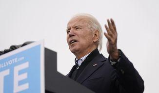 President-elect Joe Biden speaks at a drive-in rally for Georgia Democratic candidates for U.S. Senate Raphael Warnock and Jon Ossoff, Tuesday, Dec. 15, 2020, in Atlanta. (AP Photo/Patrick Semansky)