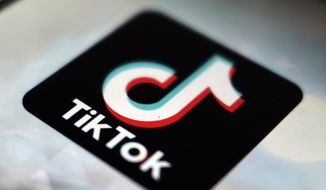 This Sept. 28, 2020, file photo shows the TikTok app logo in Tokyo. Social media and other internet companies face big fines in Britain if they don't limit the amount of harmful material such as child sexual abuse or terrorist content on their platforms, officials said Tuesday, Dec. 15, 2020. (AP Photo/Kiichiro Sato, File)