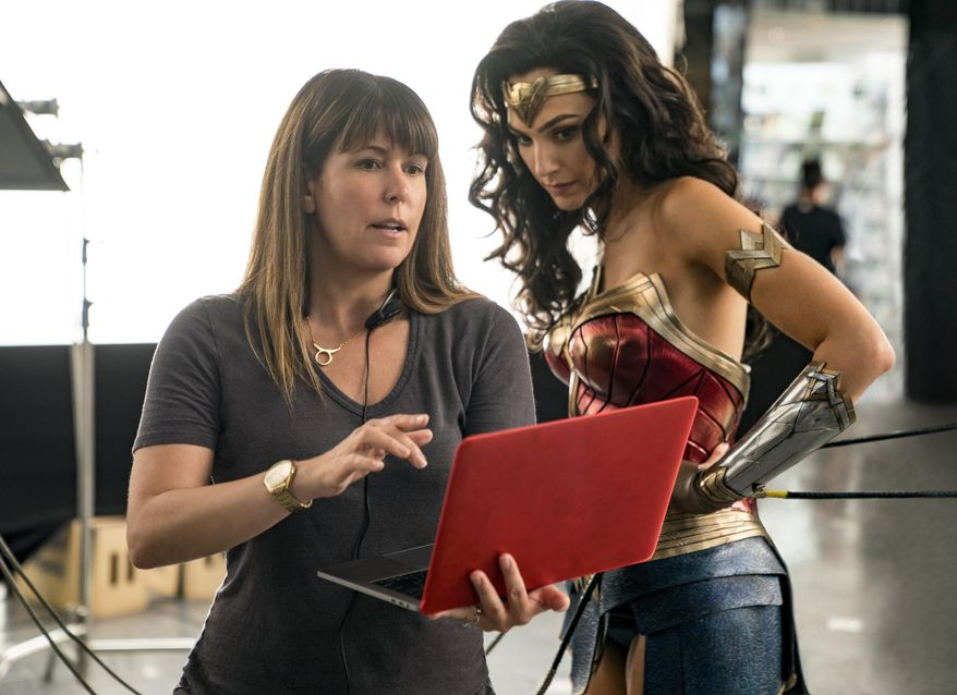 """This image released by Warner Bros. Entertainment shows director Patty Jenkins, left, with actress Gal Gadot on the set of """"Wonder Woman 1984."""" (Clay Enos/Warner Bros. Entertainment via AP)"""