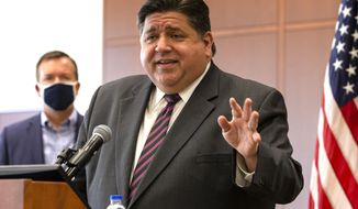FILE - In this Sept. 21, 2020, file photo, Illinois Gov. J.B. Pritzker speaks in Springfield, Ill. On Tuesday, Dec. 15, 2020, Pritzker announced roughly $700 million in budget cuts, saying Illinois faces a $3.9 billion shortfall fueled by the COVID-19 pandemic. (Justin L. Fowler/The State Journal-Register via AP, File)