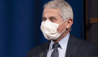 Dr. Anthony Fauci, Director of the National Institute of Allergy and Infectious Diseases at the National Institutes of Health (NIH), speaks during a ceremony awarding the Nobel Prize medal and prize to Harvey J. Alter, Laureate in Physiology or Medicine, at NIH in Bethesda, Md., Tuesday, Dec. 8, 2020. (AP Photo/Jacquelyn Martin)