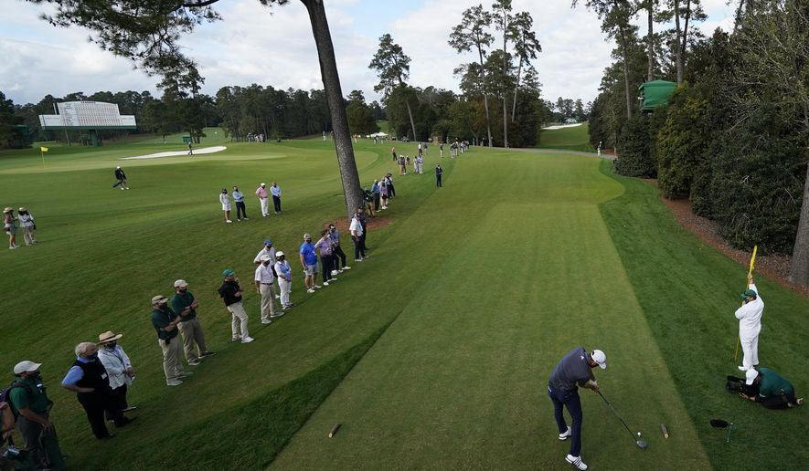 FILE - Dustin Johnson tees off on the 18th hole during the final round of the Masters golf tournament in Augusta, Ga., in this Sunday, Nov. 15, 2020, file photo. The Masters was among seven majors for men and women this year, none selling tickets to the public. (AP Photo/David J. Phillip, File)