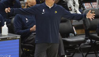 Indiana Pacers Head Coach Nate Bjorkgren calls to his team during the second half of an NBA preseason basketball game Monday, Dec. 14, 2020, in Cleveland. (AP Photo/Phil Long)