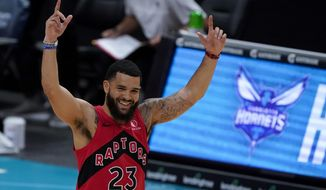 Toronto Raptors guard Fred VanVleet celebrates after scoringing against the Charlotte Hornets during the first half of an NBA preseason basketball game in Charlotte, Monday, Dec. 14, 2020. (AP Photo/Chris Carlson)