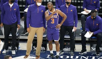 Phoenix Suns head coach Monty Williams speaks with Chris Paul (3) during the second half of an NBA preseason basketball game Monday, Dec. 14, 2020, in Salt Lake City. (AP Photo/Rick Bowmer)
